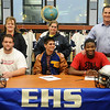 Robin Miller, Lisa Handley and EHS head football coach Steve Chard (back, from left) pause for a portrait with Logan Miller, Seth Handley and Lance Smith after the young men signed their football letters of intent Wednesday, Feb. 6, 2013. (Staff Photo by BONNIE VCULEK)
