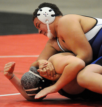 Enid's Gavin Richmond controls a Westmoore wrestler with a half-Nelson as he walks Tolbert into a pinning position during the Junior High State Wrestling Tournament at the Chisholm Trail Coliseum Saturday, Feb. 1, 2013. (Staff Photo by BONNIE VCULEK)