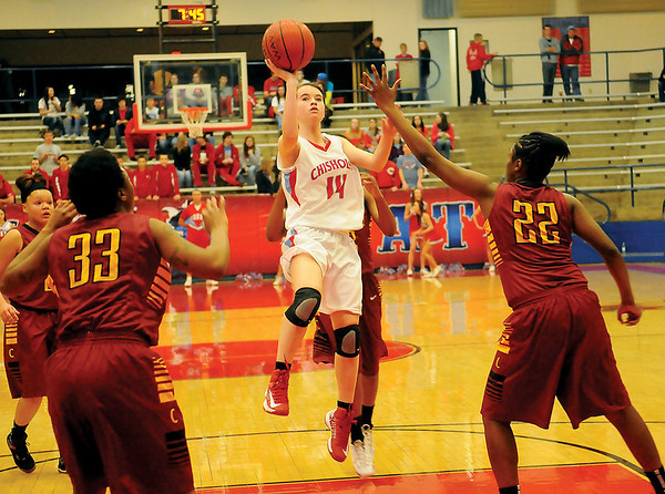 Chisholm's Megan Galusha (center) drives the lane for two against the Oklahoma Centennial Lady Bison during the OSSAA Class 3A Area 1, District 1 championship game Saturday, Feb. 16, 2013. Chisholm Lady Longhorns won 58-47. (Staff Photo by BONNIE VCULEK)