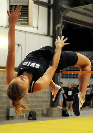 Enid's Macy Adams clears the five foot bar and wins the high jump competition at the Oklahoma Track Coaches Association Indoor Championships at the Chisholm Trail Expo Center Friday, Feb. 15, 2013. (Staff Photo by BONNIE VCULEK)