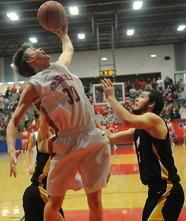Chisholm's Luke Ball grabs an offensive board against Alva's Reygan Martin (back, left) and Cade Pfleider (right) during homecoming games at Chisholm High School Friday, Feb. 1, 2013. (Staff Photo by BONNIE VCULEK)