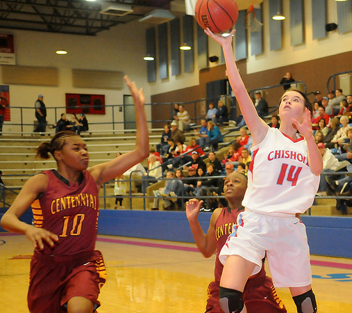 Chisholm's Megan Galusha takes the ball to the hoop for two during the Lady Longhorns 58-47 win over the Oklahoma Centennial Lady Bison in the OSSAA Class 3A Area 1, District 1 Championship Saturday, Feb. 16, 2013. (Staff Photo by BONNIE VCULEK)
