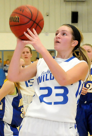 Covington-Douglas's Hailey Kaiser pulls up for a short jumper during the Lady Wildcats' win over the Drummond Lady Bulldogs at the OSSAA Class A, District 5 Girls basketball playoffs at Drummond Friday, Feb. 8, 2013. (Staff Photo by BONNIE VCULEK)