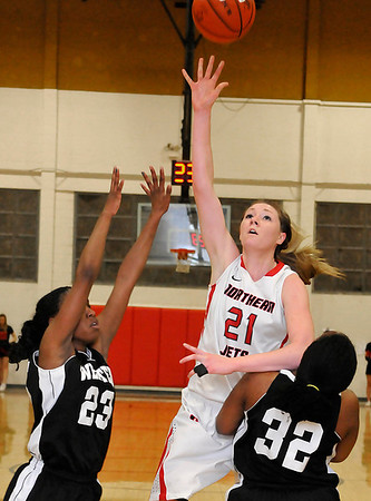 NOC's Shannon Hough shoots over Western's Mahogany Nelms and Cierra Johnson Monday at the NOC Mabee Center. (Staff Photo by BILLY HEFTON)