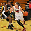 NOC's Christa Beasler drives the baseline against Western's Mahogany Nelms  Monday at the NOC Mabee Center. (Staff Photo by BILLY HEFTON)