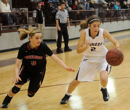 Pioneer's Carli Woolsey (right) steals the ball from Morrison's Jacey Bales during the OSSAA District Basketball Playoffs at Pioneer High School Friday, Feb. 15, 2013. (Staff Photo by BONNIE VCULEK)