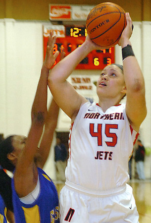 NOC's Marisha Wallace shoots over Jordan Franks of Eastern Monday at the NOC Mabee Center. (Staff Photo by BILLY HEFTON)
