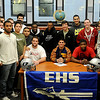 Enid High School Plainsmen (seated, from left) Logan Miller, Seth Handley and Lance Smith, pause for a portrait with their teammates during their football letter of intent signing day ceremony in the EHS Library Wednesday, Feb. 6, 2013. (Staff Photo by BONNIE VCULEK)