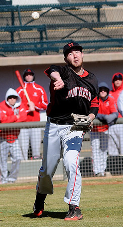 NOC-Enid Jets' Zach Postoak fields a bunt from a DMACC batter and throws to first at David Allen Memorial Ballpark Saturday, Feb. 16, 2013. (Staff Photo by BONNIE VCULEK)