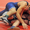 Enid's Gabrielle Farias scores two points as he takes Edmond North's Cayman Robertson to the mat during the Jr. High State Wrestling Tournament at the Chisholm Trail Coliseum Saturday, Feb. 2, 2013. Farias defeated Robertson 7-6. (Staff Photo by BONNIE VCULEK)