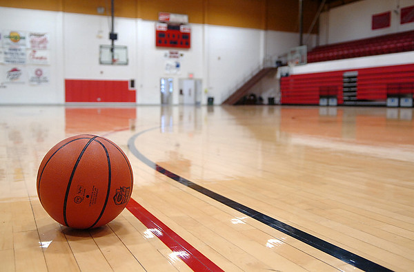 A basketball sits idle on the floor of the NOC Mabee Center Tuesday. The Enid High basketball games vs Stillwater scheduled for Tuesday night were cancelled due to the weather. At this time the games are unlikely to be rescheduled. (Staff Photo by BILLY HEFTON)