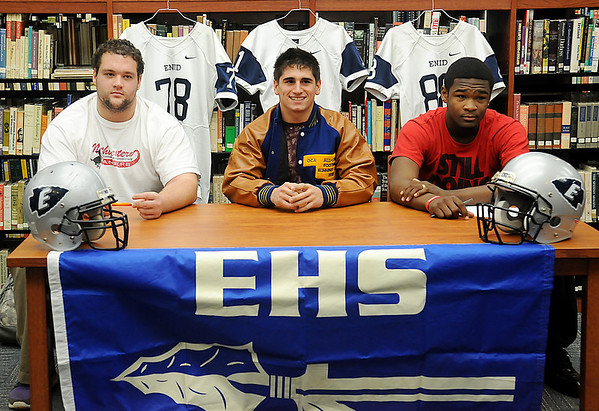 Enid High School Plainsmen (from left) Logan Miller, Seth Handley and Lance Smith pause for a portrait before signing their football letters of intent Wednesday, Feb. 6, 2013, in Enid, Oklahoma. (Staff Photo by BONNIE VCULEK)