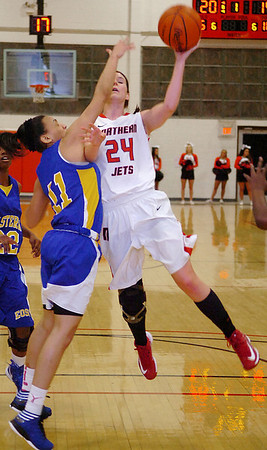 NOC's Christa Beasler makes contact with Eastern's Rebecca Stewart as she drives to the basket Monday at the NOC Mabee Center. (Staff Photo by BILLY HEFTON)