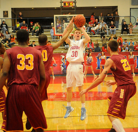 Chisholm's Luke Ball (center) hits a three from the top of the key against the Oklahoma Centennial Bison Saturday, Feb. 16, 2013. (Staff Photo by BONNIE VCULEK)