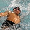 Enid's Gabe Sanchez flies through the water as he swims and wins the boys 15-18 100 yard backstroke during the Pacers and Plainsmen's swim meet against Piedmont at the Denny Price Family YMCA Friday, Feb. 8, 2013. (Staff Photo by BONNIE VCULEK)