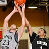 NOC's Dalen Qualls tussels with Western's Dil Jon Allen-Jordan for a rebound Monday at the NOC Mabee Center. (Staff Photo by BILLY HEFTON)