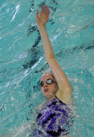 Enid's Whitney Livesay swims the backstroke at the Denny Price YMCA Thursday, Feb. 7, 2013. Livesay and the rest of the Enid High School swim team will host Peidmont today during senior night festivities. (Staff Photo by BONNIE VCULEK)