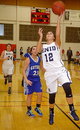 Enid's Courtney Chelf scores a fastbreak basket against Guthrie Tuesday at the NOC Mabee Center. (Staff Photo by BILLY HEFTON)
