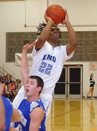 Enid's Correll Baker shoots over Guthrie's Justice Irvin Tuesday at the NOC Mabee Center. (Staff Photo by BILLY HEFTON)