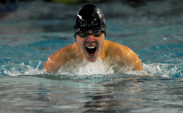 Enid's Jeremy Crise cruises to first place during the Boys 15-18 100 yard breaststroke at the Denny Price Family YMCA Friday, Feb. 8, 2013. (Staff Photo by BONNIE VCULEK)