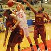 Chisholm's Faith Mirelez scores against two Oklahoma Centennial Lady Bison Saturday, Feb. 16, 2013. (Staff Photo by BONNIE VCULEK)