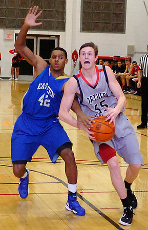 NOC'sConnor Brooks has the ball stripped away by Eastern's Iman Johnson as he drives to the basket Monday at the NOC Mabee Center. (Staff Photo by BILLY HEFTON)