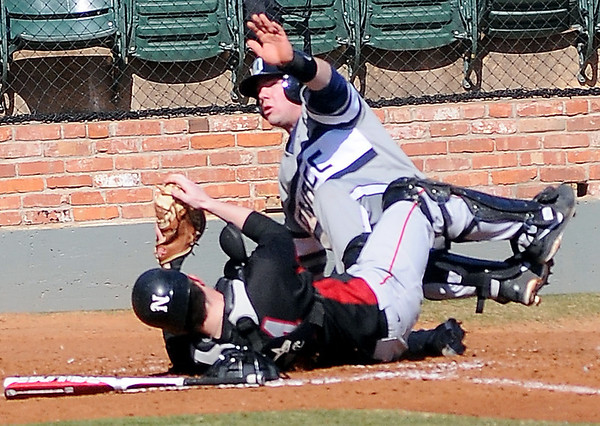 NOC-Enid Jets' Keaton Webb and DMACC Bears' Shea Molitor collide at the plate as Webb tags Molitor out at the plate at David Allen Memorial Ballpark Saturday, Feb. 16, 2013. (Staff Photo by BONNIE VCULEK)