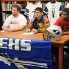 Enid High School Plainsmen (from left) Logan Miller, Seth Handley and Lance Smith sign their football letters of intent at the Enid High School Library Wednesday, Feb. 6, 2013. Handley (center), an OCA All-State running back, has committed to East Central University. Miller and Smith will be at Northwestern Oklahoma State University. (Staff Photo by BONNIE VCULEK)