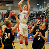 Chisholm's Caleb Lang hits two as four Alva Goldbugs pressure Lang Friday, Feb. 1, 2013. (Staff Photo by BONNIE VCULEK)