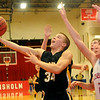 Alva's Reygan Martin drives the lane for two as Chisholm's Reid Weber defends at Chisholm High School's Paul J. Outhier field house Friday, Feb. 1, 2013. (Staff Photo by BONNIE VCULEK)