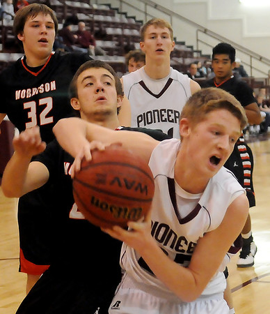 Pioneer's Nicholas Denker (front) rebounds for a put-back against Morrison's Kyle Collins during the OSSAA District Basketball Playoffs at Pioneer High School Friday, Feb. 15, 2013. (Staff Photo by BONNIE VCULEK)