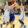 Covington-Douglas Lady Cats' Jessi Parsons (left) and Baylie Kaiser (right)  battle for the ball with Drummond's Emily Perry during the Lady Cats' OSSAA Class A, District 5 girls win over the Lady Bulldogs at Drummond High School Friday, Feb. 8, 2013. (Staff Photo by BONNIE VCULEK)