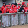 NOC Enid Jets try to keep warm as they cheer on their teammates during a home opening double-header against Cloud County at David Allen Memorial Ballpark Saturday, Feb. 9, 2013. (Staff Photo by BONNIE VCULEK)