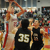Chisholm's Reid Weber (left) scores over Alva's Cade Pfleider (center) and Cody Forell at Chisholm High School's Paul J. Outhier field house Friday, Feb. 1, 2013. (Staff Photo by BONNIE VCULEK)