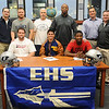 Logan Miller, Seth Handley and Lance Smith (front, from left) pause for a portrait with their Enid High School Plainsmen coaches as the EHS seniors sign their football letters of intent Wednesday, Feb. 6, 2013. Miller and Smith have committed to Northwestern Oklahoma State University and Handley will play at East Central University. (Staff Photo by BONNIE VCULEK)