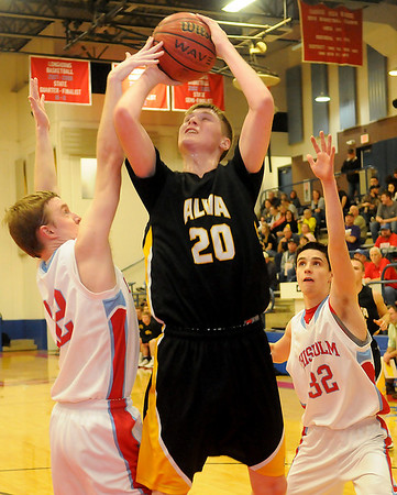 Chisholm's Caleb Lang blocks a shot by Alva's Lane Madsen as Chisholm's Danner Kiernan applies additional pressure on Madsen from behind during the basketball action at Chisholm High School's Paul J. Outhier field house Friday, Feb. 1, 2013. The Alva Goldbugs had a 31-30 lead over the Chisholm Longhorns at the half. (Staff Photo by BONNIE VCULEK)