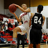 NOC Enid's Kiara Moore looks to pass against Western's Tatyana Bell Thursday at the NOC Mabee Center. (Staff Photo by BILLY HEFTON)