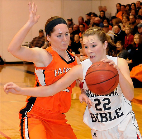 Fairview's Karley Boyer pressures OBA's Erin Coffin during the Lady Jackets' 63-34 win over the Lady Trojans at Oklahoma Bible Academy Friday, Feb. 7, 2014. (Staff Photo by BONNIE VCULEK)