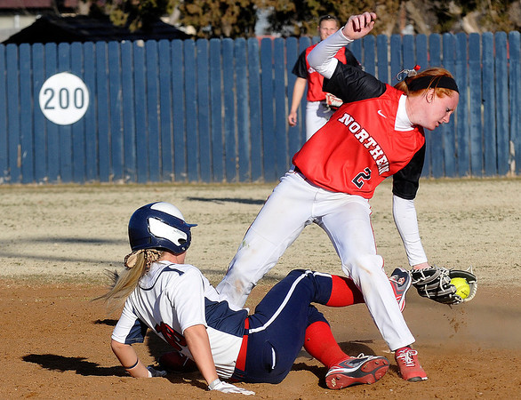NOC's Lauryne Dester gets tangled with Makenzi Shackley of Hutchinson Community College after make a tag at second base Saturday at Meadowlake Park. (Staff Photo by BILLY HEFTON)