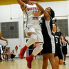 NOC Enid's Tierra Coffey puts up a shot against Western's Briana Underwood Thursday at the NOC Mabee Center. (Staff Photo by BILLY HEFTON)