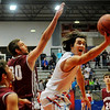 Chisholm's Bryson Rolfe drives to the hoop for two against Watonga Friday, Feb. 14, 2014. (Staff Photo by BONNIE VCULEK)