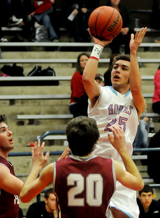 Chisholm's Austin Grieshober pulls up for two against two Watonga defenders Friday, Feb. 14, 2014. (Staff Photo by BONNIE VCULEK)
