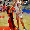 Chisholm's Kaylee Petersen puts up a shot over OBA's Erin Coffin Tuesday at Chisholm High School. (Staff Photo by BILLY HEFTON)
