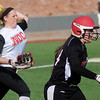 NOC Enid's Selika Shives throws the ball to Bailey King for an out at first during a double-header at David Allen Memorial Ballpark Friday, Feb. 28, 2014. (Staff Photo by BONNIE VCULEK)