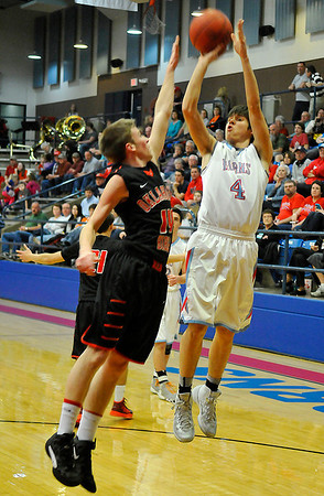 Chisholm's Trevor Galusha shoots over OBA's Blaine Whitson Tuesday at Chisholm High School. (Staff Photo by BILLY HEFTON)