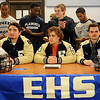 Enid Plainsmen football players (seated from left) Stephen Hocker, Sam Clemens and Mason Camp react as their senior classmates, family and friends applaud during the players' national football signing day at the Enid High School library Wednesday, Feb. 5, 2014. (Staff Photo by BONNIE VCULEK)