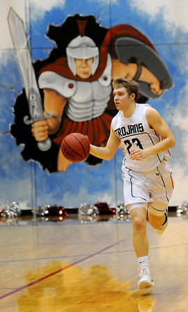 OBA's Preston Atwood brings the ball up the court Friday, Feb. 7, 2014. (Staff Photo by BONNIE VCULEK)