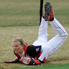 NOC Lady Jets' Avery Walker makes a diving catch in left field at David Allen Memorial Ballpark Wednesday, Feb. 19, 2014. (Staff Photo by BONNIE VCULEK)