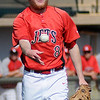 NOC Enid Jets' Jon Chidester fields an infield ball and tosses it to first for an out against Hesston at David Allen Memorial Ballpark Saturday, Feb. 22, 2014. (Staff Photo by BONNIE VCULEK)