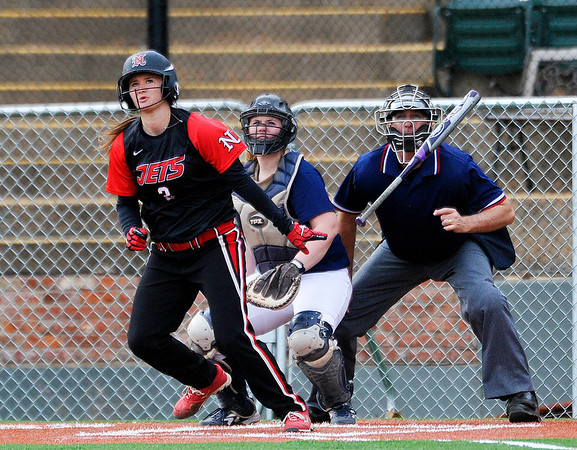 NOC Enid's Kendra Coleman watches the flight of her home run against Colby Community College Friday at David Allen Memorial Ballpark. (Staff Photo by BILLY HEFTON)